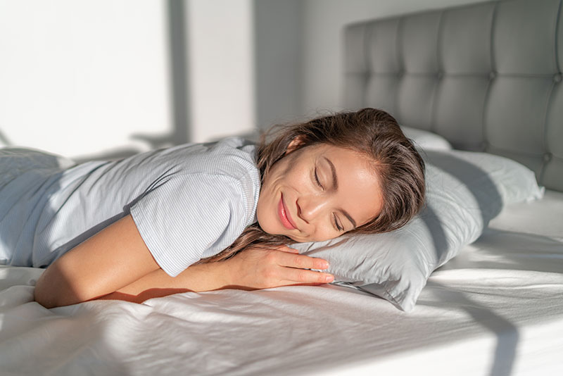 woman relaxing on her clean bed